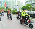 文明骑行 星城表率        长沙市开福区湘江路,长沙交警领骑电动车车队,倡导文明骑行。